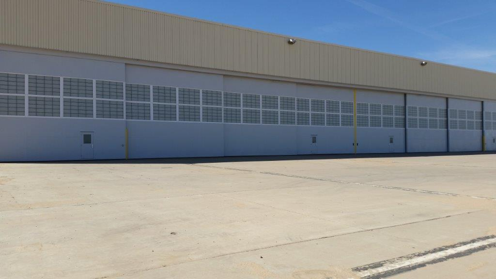 ... steel sliding hangar doors (aircraft bottom rolling horizontal hangar doors) for building 9620 at Butts Army Airfield (BAAF) Fort Carson Colorado. & Adjoiner Corporation Hangar Door Replacement - Beckrich Construction